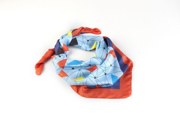 red and blue flying macaws design on silk scarf